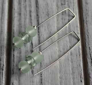 Long earrings.  Handmade glass beads made from a Green Depression Glass Platter