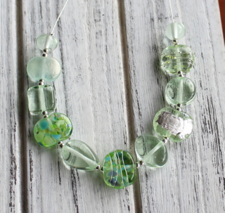 A Green Depression Glass platter was used to make the beautiful beads in this necklace.
