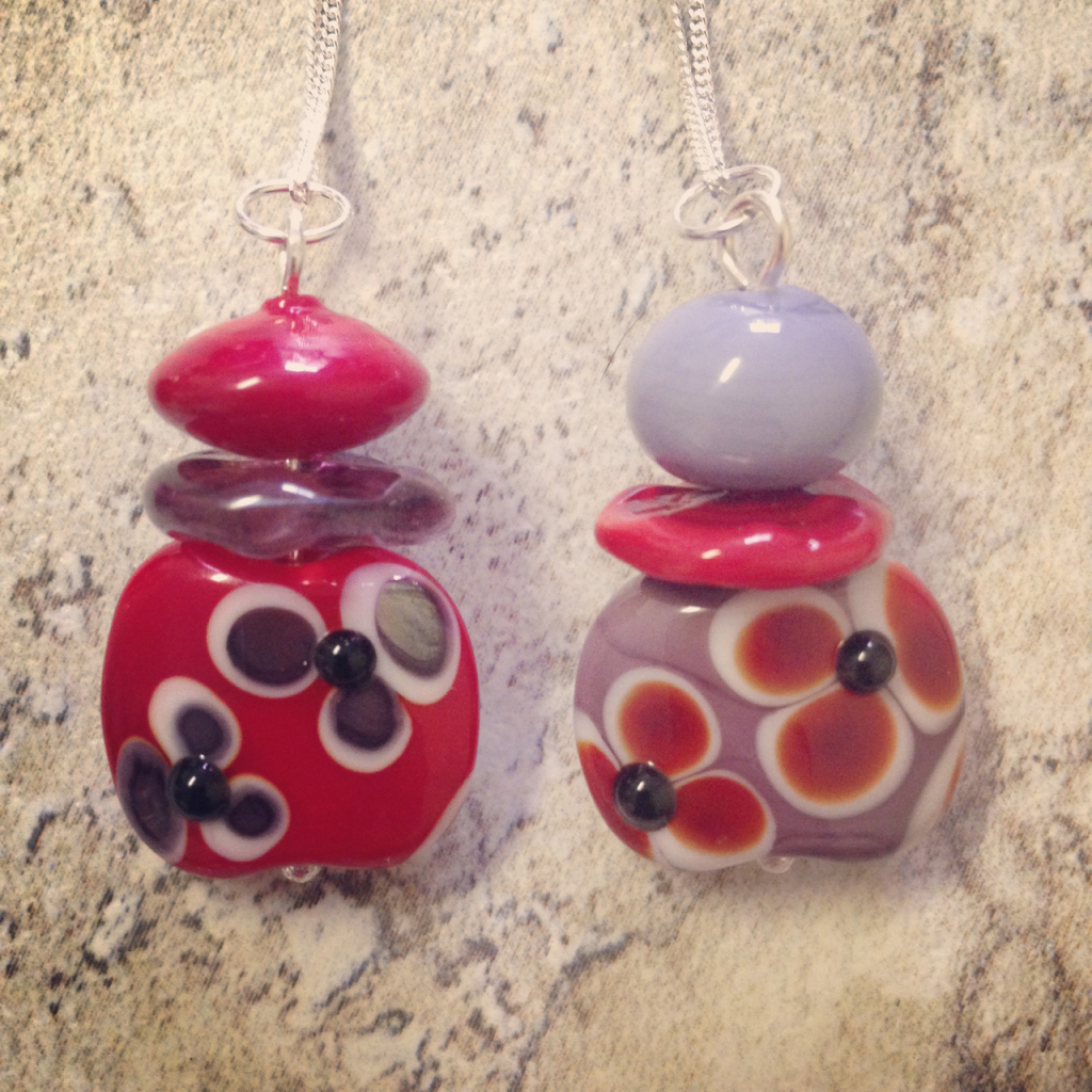 Beautiful flower pendants with handmade glass beads by Julie Frahm