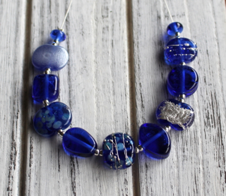 Handmade glass beads from a Skyy Vodka bottle!
