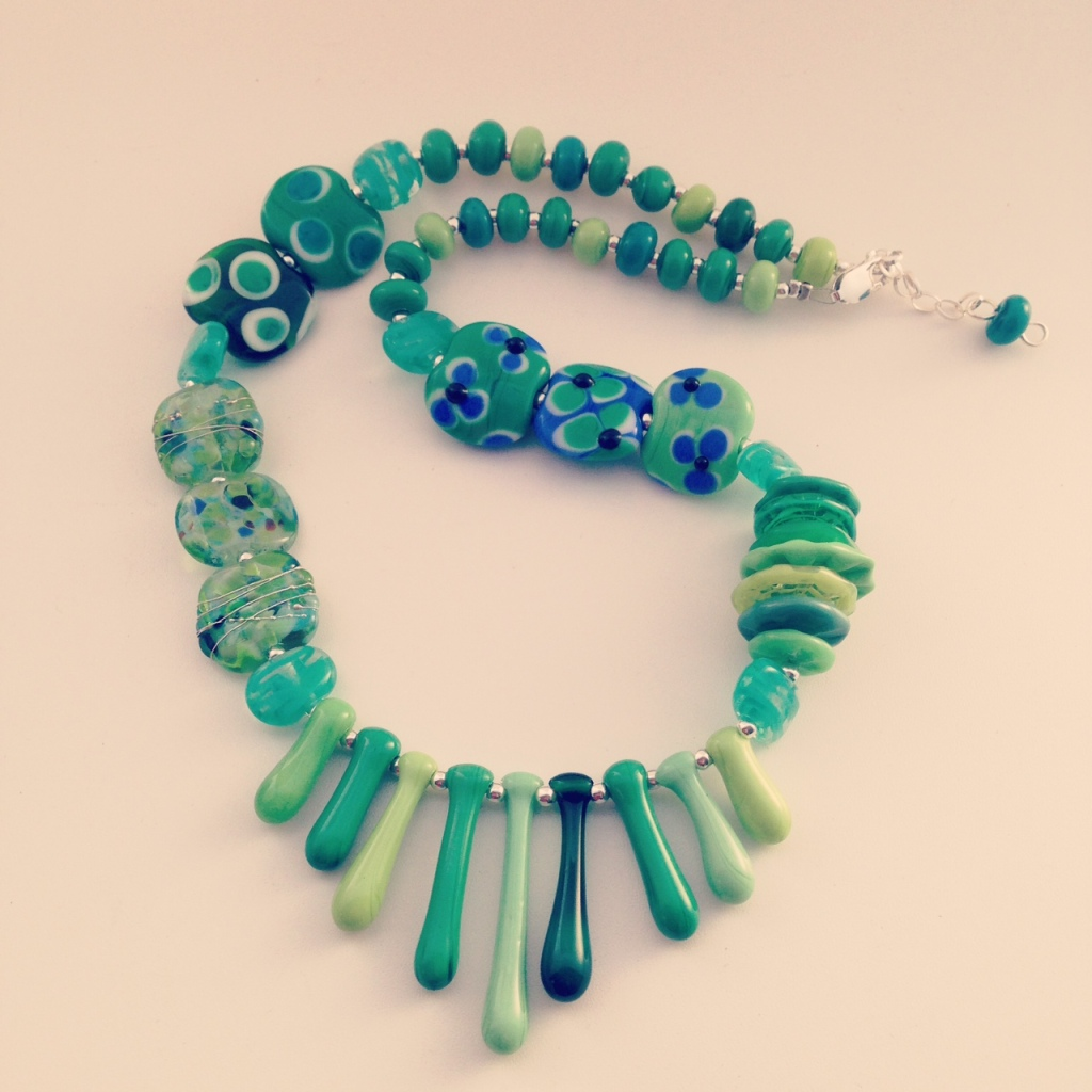 Beautiful Green Necklace with a splash of blue (handmade glass beads)
