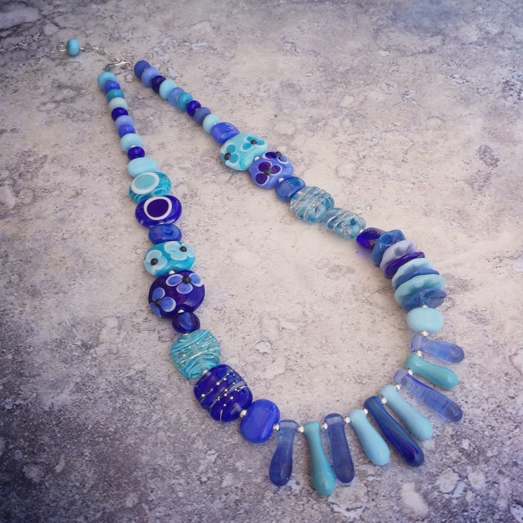 Stunning necklace, made with a selection of handmade glass beads by Julie Frahm