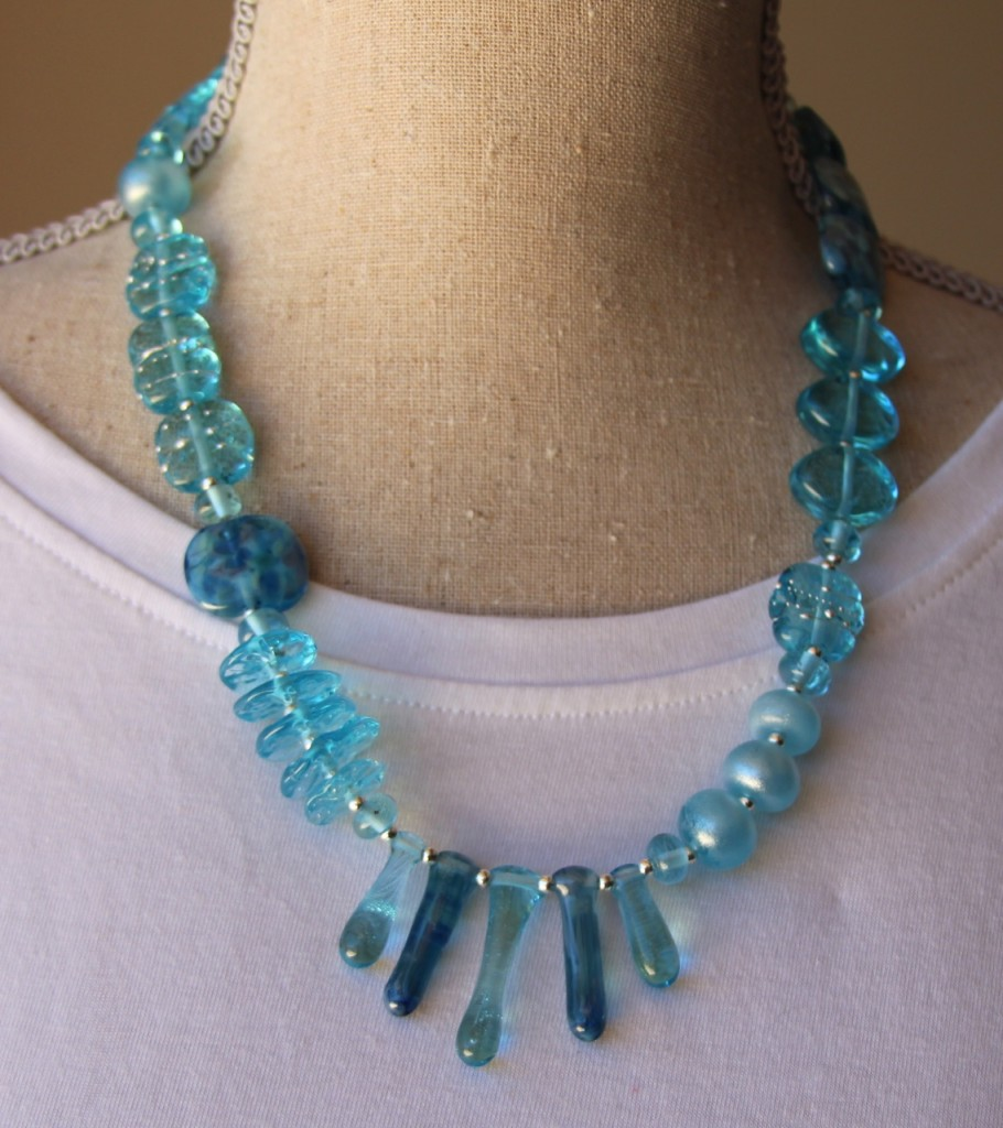 Asymmetrical necklace - beads made from a Bombay Sapphire Gin bottle