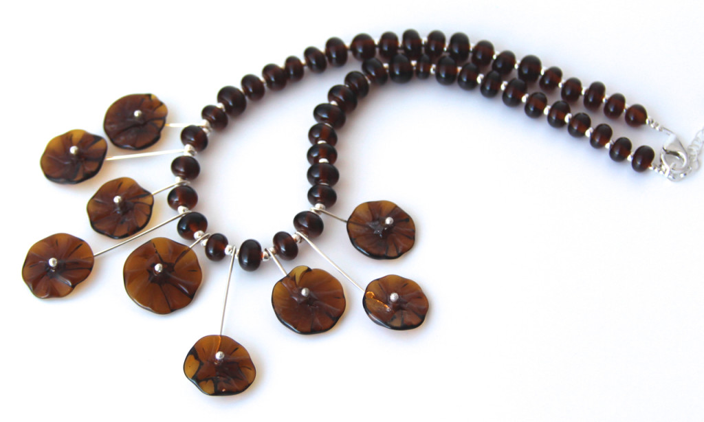 Handmade recycled glass beads, beads made from a Coopers Ale bottle.