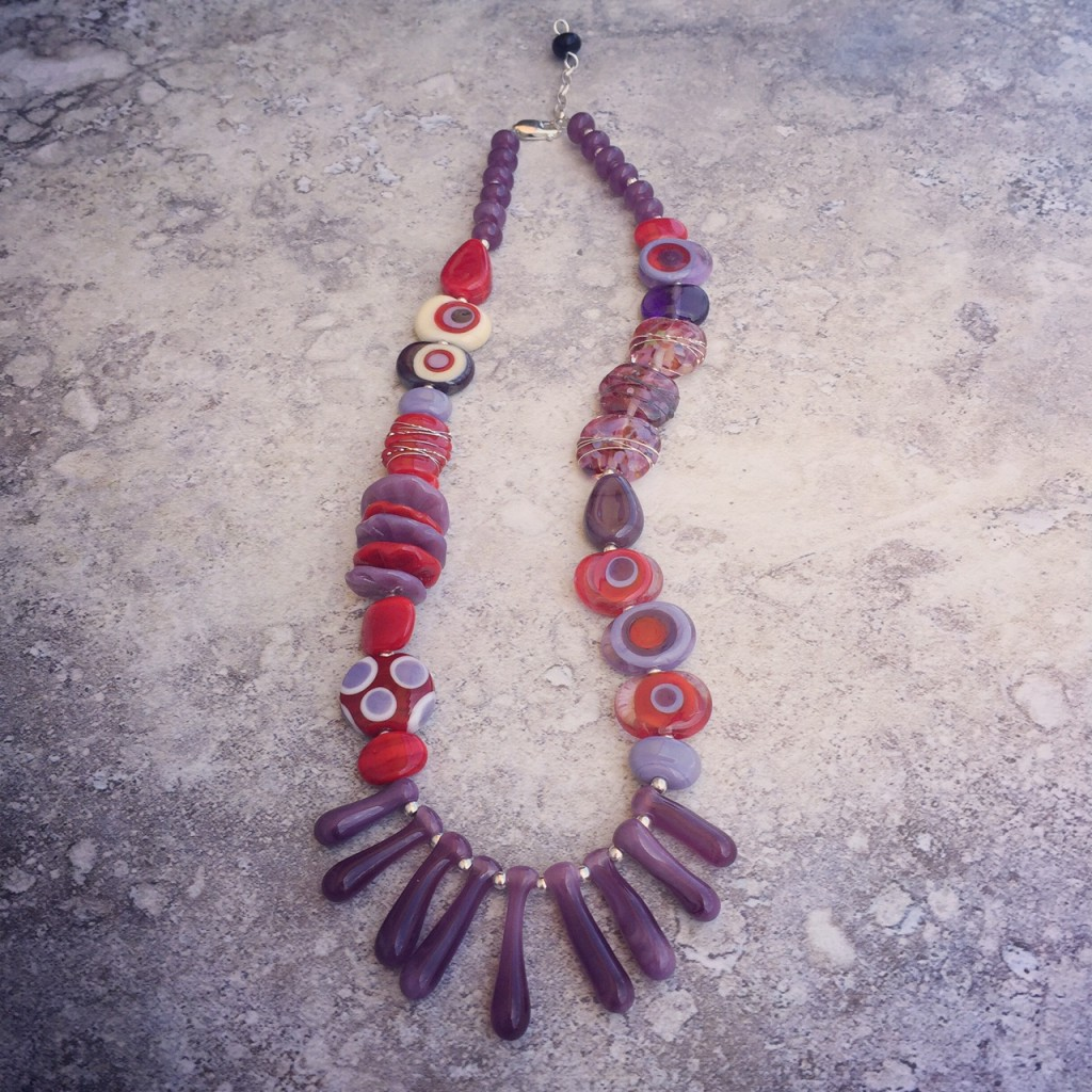 Gorgeous red and purple handmade glass bead necklace by Julie Frahm