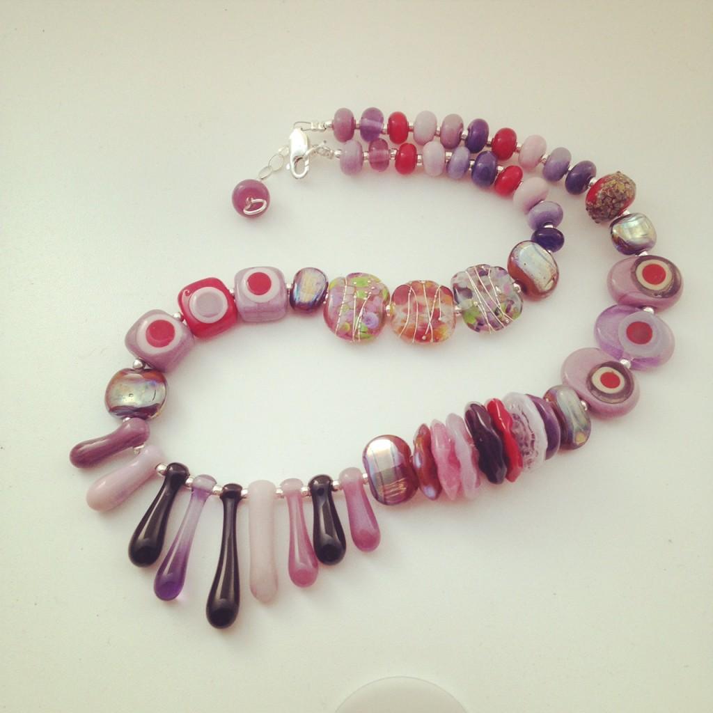 Beautiful selection of purple handmade glass beads by Julie Frahm