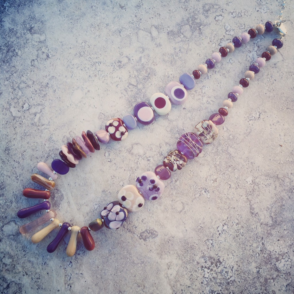 Combining purple and brown handmade glass beads by Julie Frahm