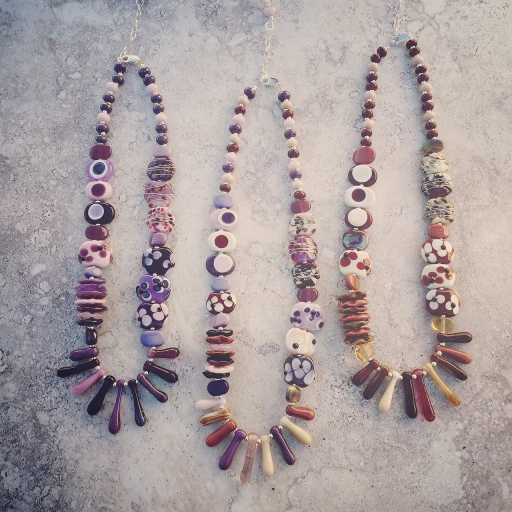 Love these purple and brown necklaces by Julie Frahm.  Handmade glass beads.