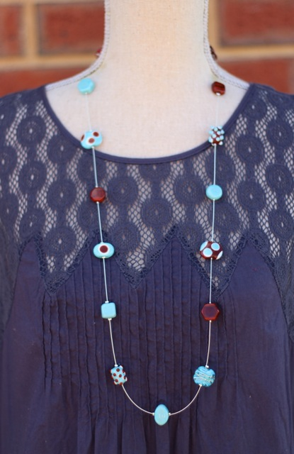 Long turquoise and brown necklace with handmade glass beads by Julie Frahm