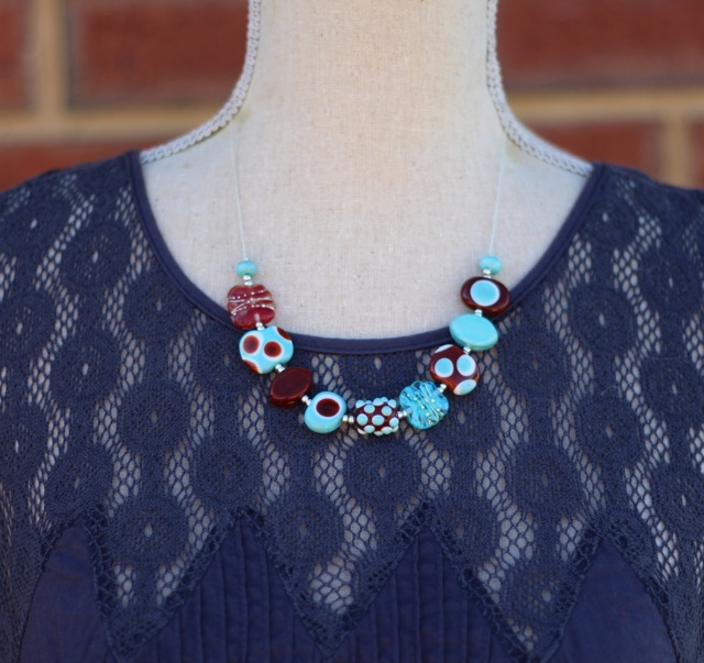 Short brown and turquoise necklace with handmade glass beads by Julie Frahm