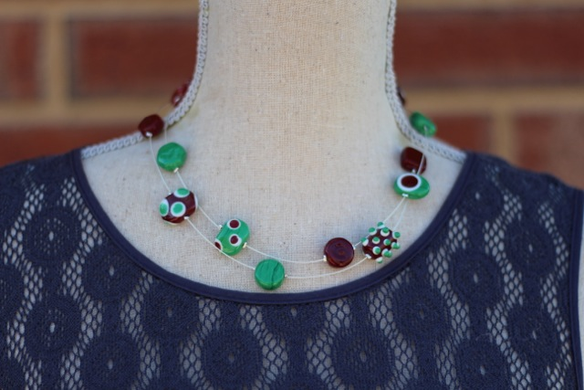 Long brown and green handmade glass bead necklace by Julie Frahm - worn doubled