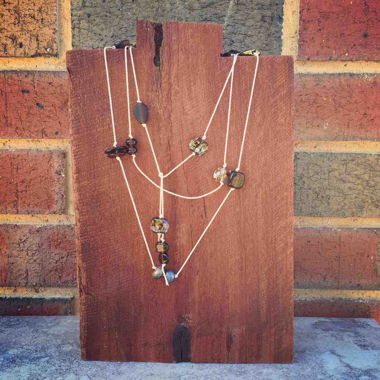 Lariat style necklace made with handmade recycled glass beads by Julie Frahm