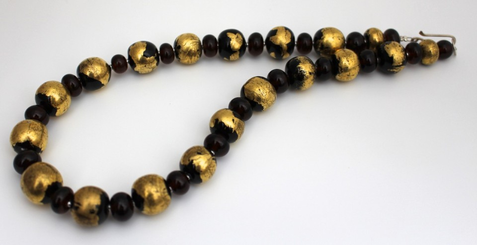 Handmade recycled glass beads, made from a Coopers Ale bottle, and decorated with 14K gold leaf