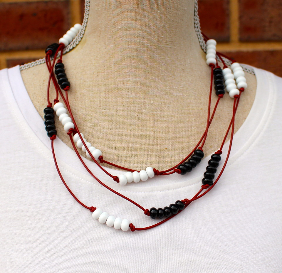 Black and white bead necklace on red leather, handmade glass beads by Julie Frahm