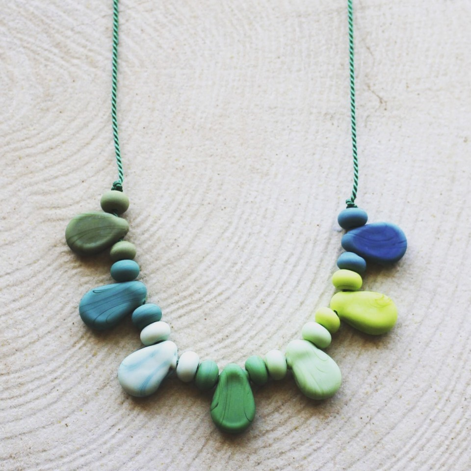 Etched green glass beads on silk necklace