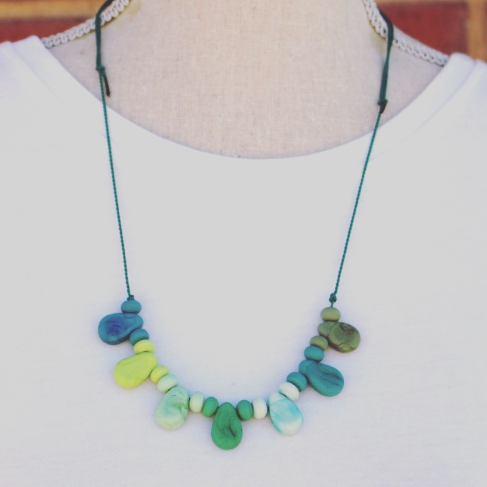 Etched green glass bead necklace on silk cord