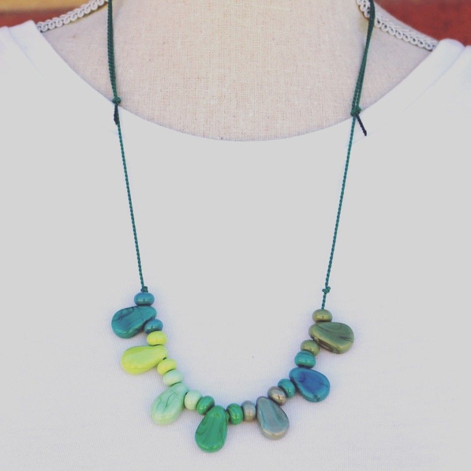 Shiny green glass beads on silk cord necklace