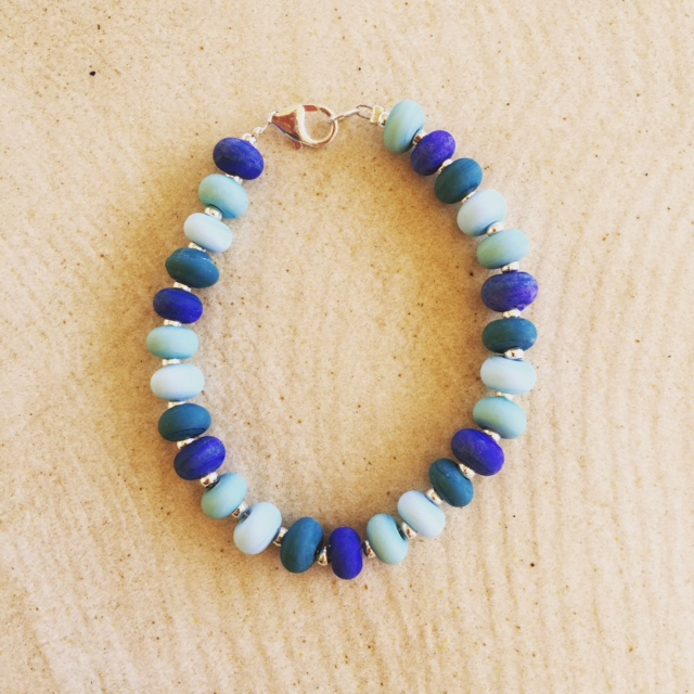 Etched blue glass bead bracelet
