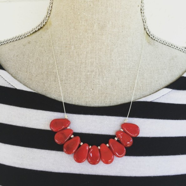 Red handmade glass beads on silver wire necklace