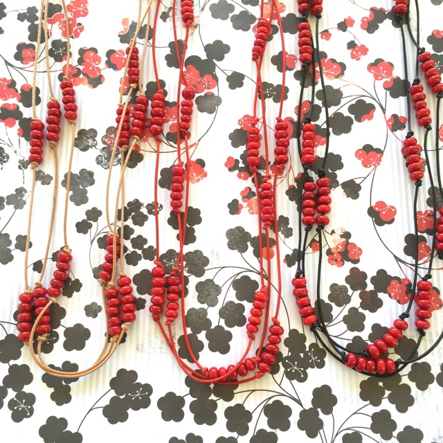 Handmade red glass beads on leather necklaces