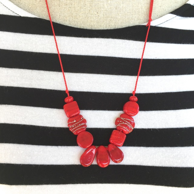 Red glass bead necklace on silk cord