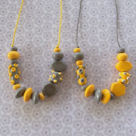 Grey and Yellow glass bead necklaces on silk cord