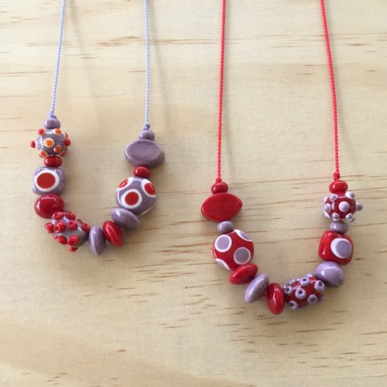 Red and purple handmade glass bead necklaces by Julie Frahm