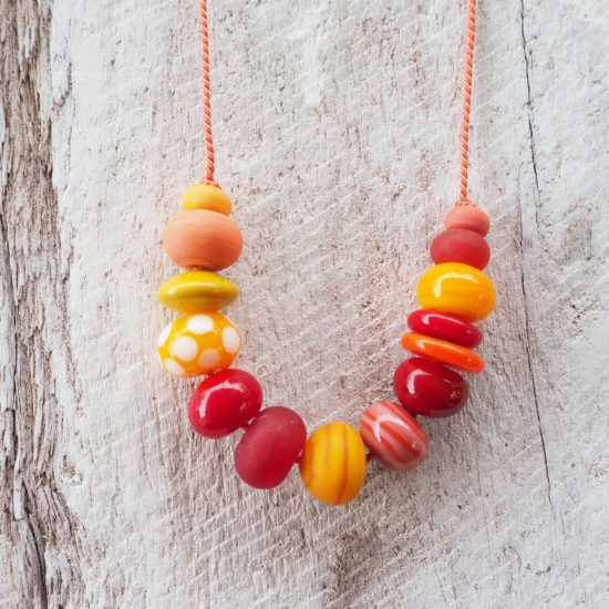 orange handmade glass bead necklace