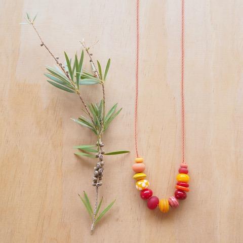 orange handmade glass bead necklace