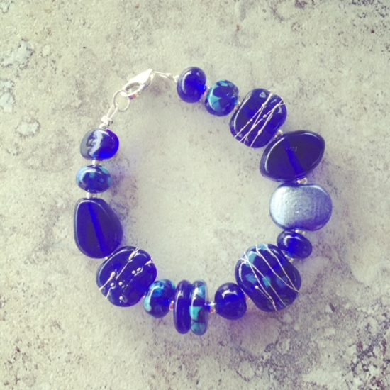 recycled glass bracelet featuring beads made from a Skyy Vodka bottle