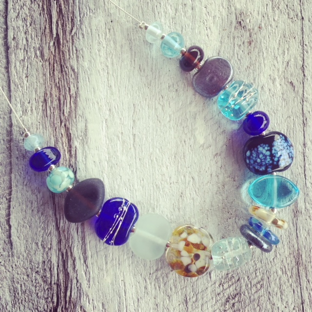 Recycled glass necklace | blue and brown beads made from various recycled glass objects