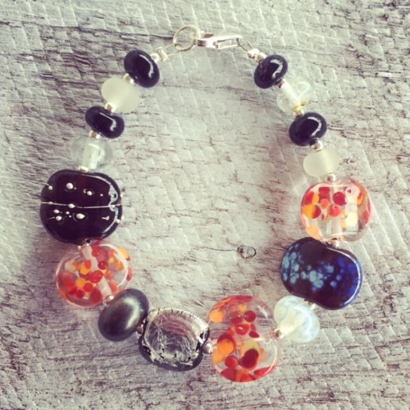 Recycled glass bead bracelet | beads made from gin and tonic water bottles in classic red/black/white colour combination
