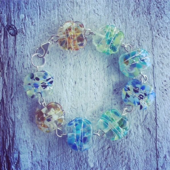 Recycled glass beads | the beads in this bracelet were made from a wine bottle