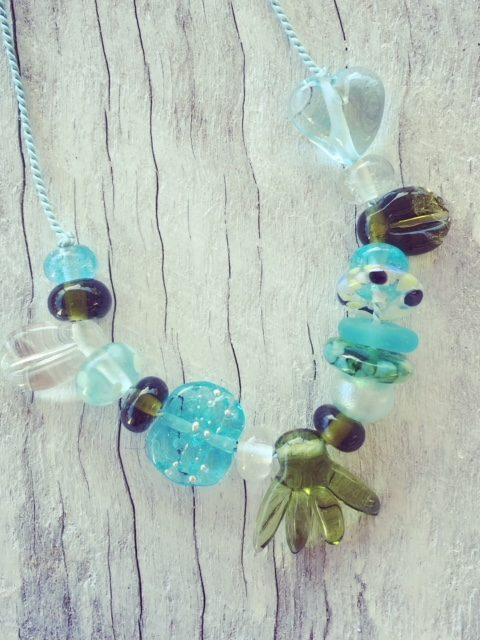 Recycled glass necklace   beads made from wine and gin bottles on silk cord