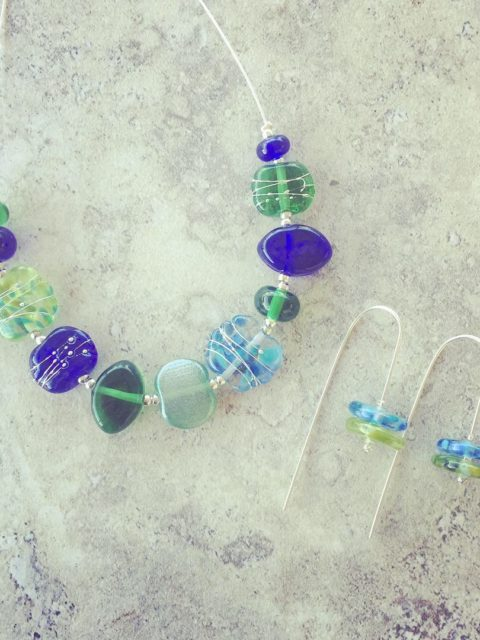 Recycled glass jewellery   blue and green glass beads made from gin, vodka and wine bottles.
