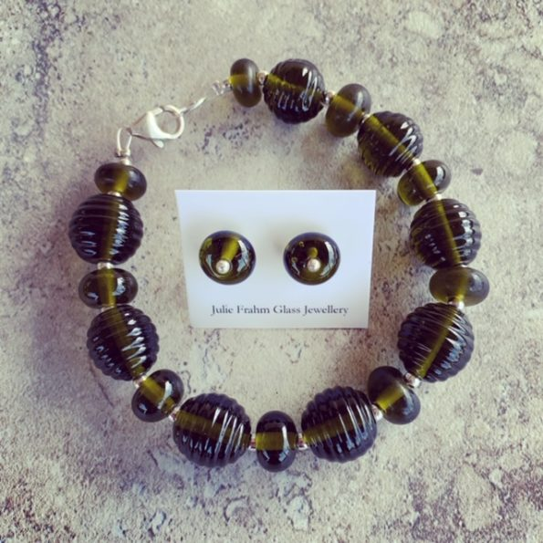 Recycled glass jewellery | beads featured in the bracelet and stud earrings are from a Stones Green Ginger Wine bottle