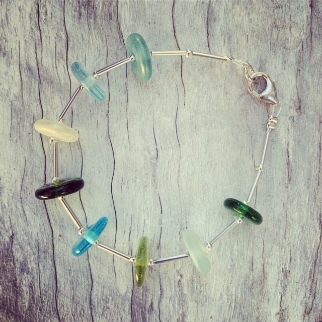 Recycled glass bead bracelet | beads made from various glass objects, sterling silver spacers