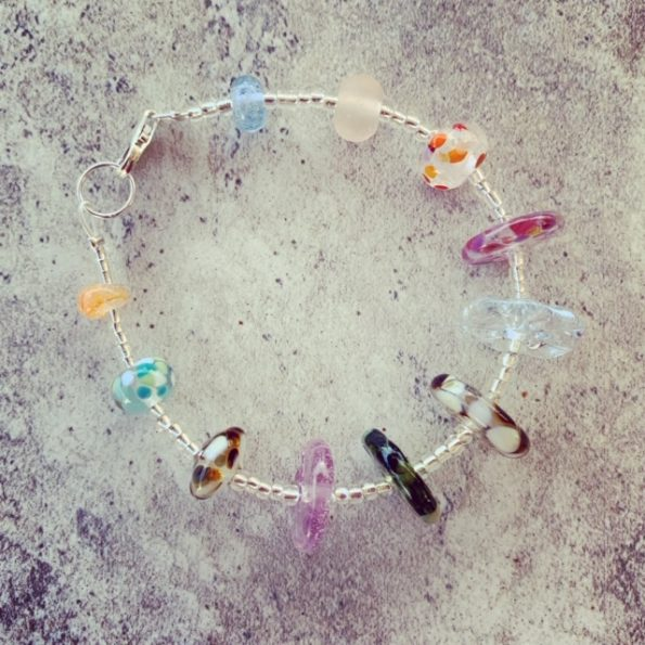 Recycled glass bracelet | beads made from a mix of recycled glass objects