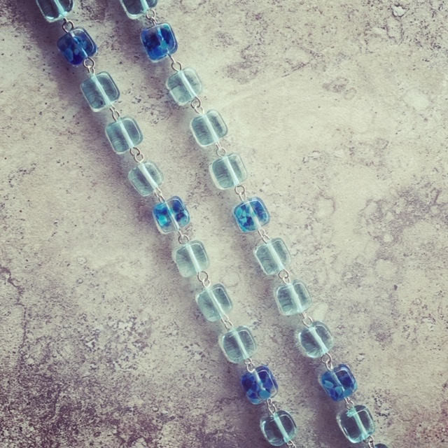 Recycled glass bead necklace, featuring beads made from wine bottles