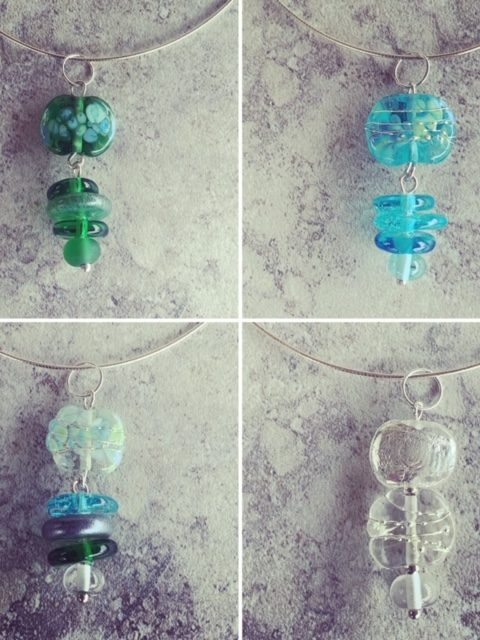 Gin and tonic pendant necklaces featuring beads made from Tanqueray and Bombay Sapphire Gin, plus Fever-Tree tonic water bottles