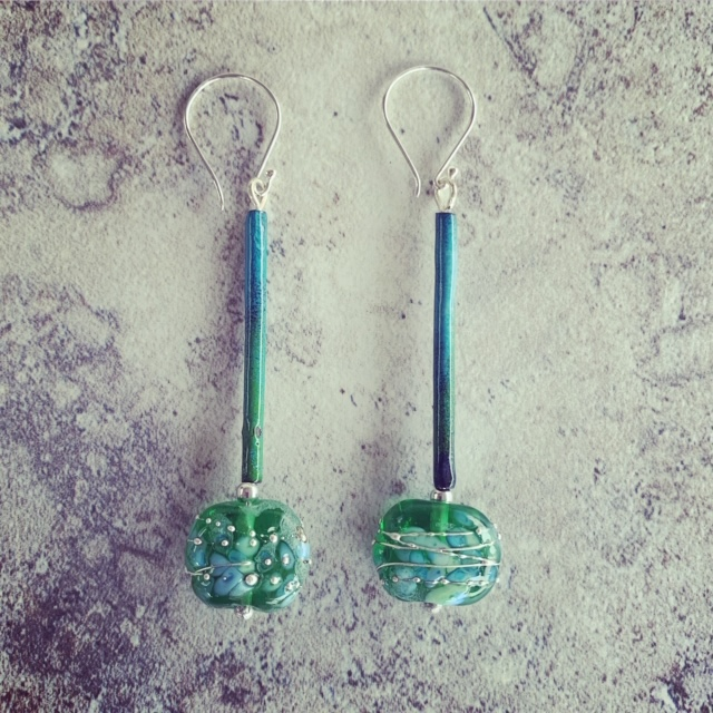 Long earrings made from a Tanqueray Gin bottle