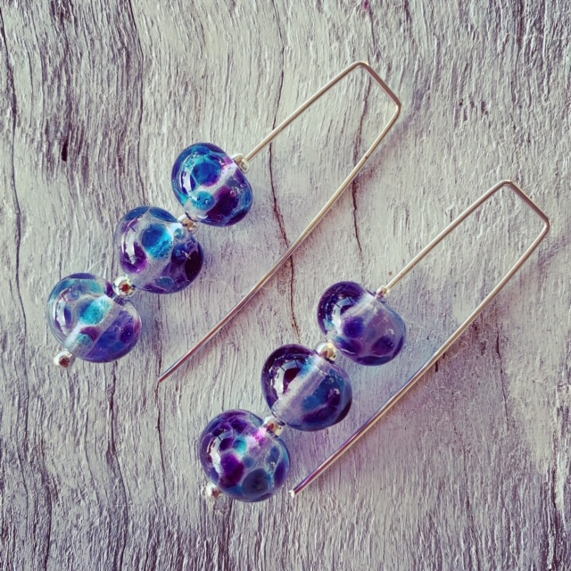 Long dark blue glass earrings made from a wine bottle
