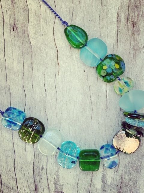 Adjustable silk cord necklace with recycled glass beads