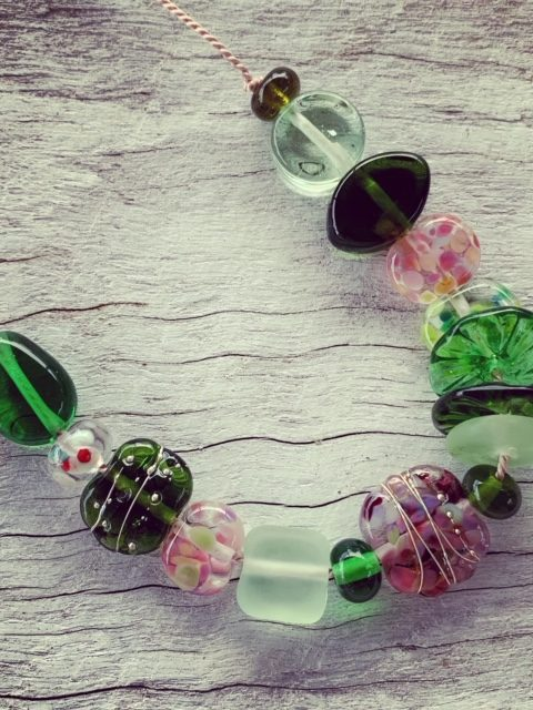 Pink and green recycled glass necklace on silk cord