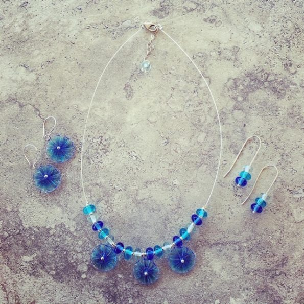 Blue glass flower necklace and matching earrings