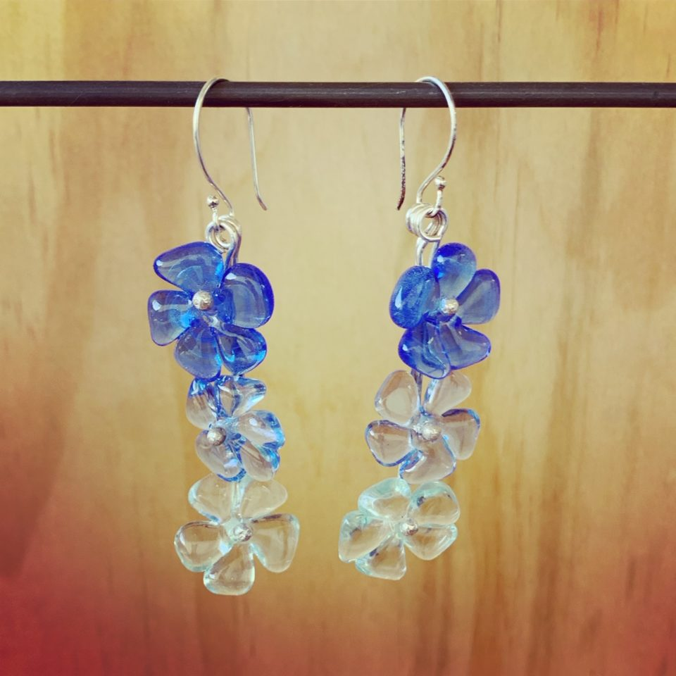 Really long blue glass flower earrings
