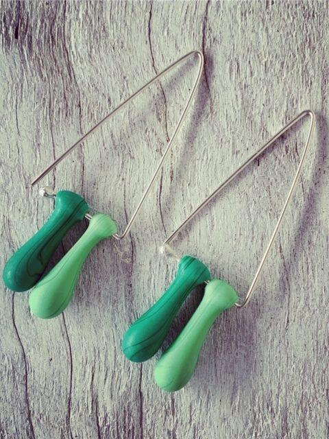 Long green triangle earrings