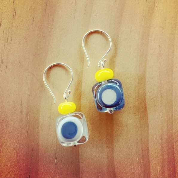 Grey earrings with a pop of yellow