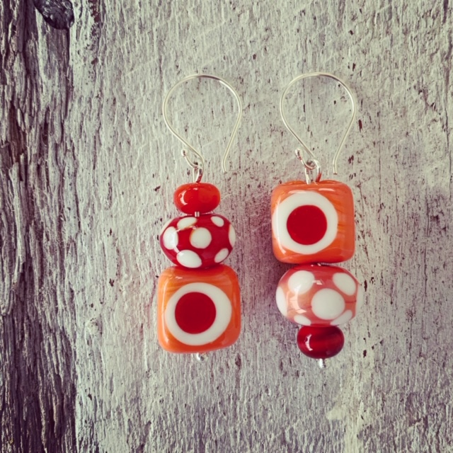 red coral asymmetrical glass bead earrings