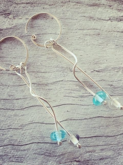 Long, curly Bombay Sapphire Gin earrings